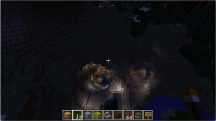 A nighttime view from above the cave